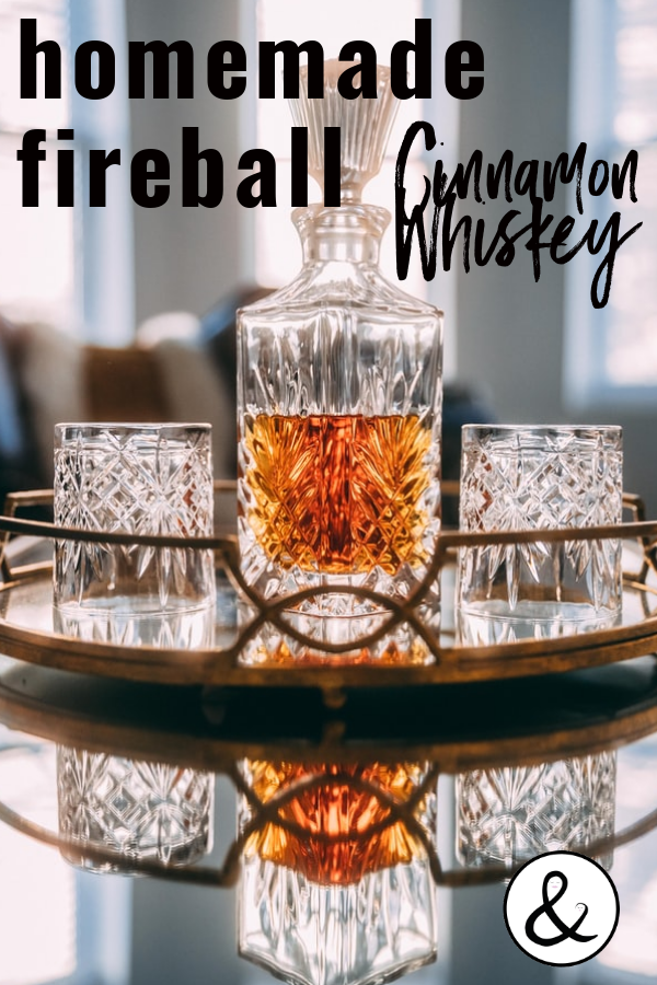 This DIY homemade fireball cinnamon whiskey recipe has no additives or dyes. Make your own cinnamon whiskey cocktails like an old fashioned or cider. #fireball #cinnamonwhiskey #whiskeyrecipe #fireballdrinks
